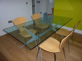 Contemporary Glass dining table and 4 chairs