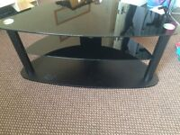 """TV STAND WITH TEMPERED BLACK GLASS SHELVES, SUITABLE FOR UPTO 60"""" INCH SIZE TELLY, GOOD CONDITION."""