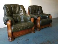 2 GREEN LEATHER ARMCHAIRS ON SOLID WOODEN FRAMES QUALITY CHAIRS DELIVERY AVAILABLE