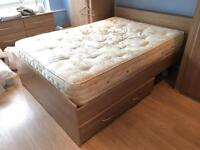 Double bed with mattress and under bed storage drawers. And head board.