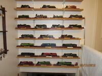 NOW SELLING FOR £50. (£1.35ea.) MODEL TRAINS ON PLINTHS