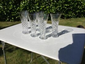 Set of six cut glass beer style flutes.