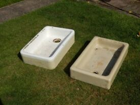 Two old kitchen sinks for growing plants.