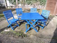 Wooden patio table and four chairs. Table is 84cm square
