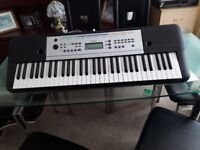 yamaha key board still in box used twice charger instuction 385 voices 100 styles 61 full size keys.
