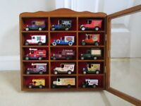 15 model toy cars in display case.