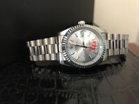 Rolex Datejust Stainless steel case with a stainless steel oyster bracelet.