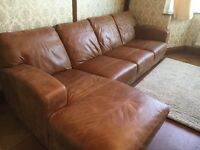 DFS tan leather chaise sofa. 2 years old still under warranty