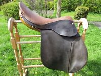 Horse saddle 17.Black and tan in fair condition,wear to rear of seat but no splits in leather