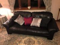 Black leather sofa and two matching chairs