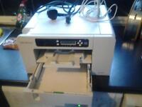 dye sublimation printer as good as new just needs ink comes with wires and paper