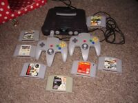 NINTENDO 64 WITH GAMES MEM CARD AND 2 CONTROLLERS