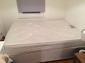Double divan bed with orthopaedic mattress