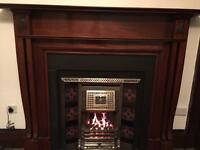 Gas fire place with splendid wooden mantle and surround