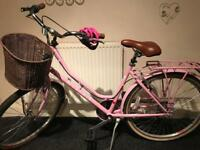 Woman's pink Dutch style bike