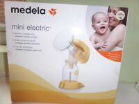 medela mini electric breast pump including some spare bottles/one teat £20