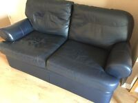 Large leather 2 seater sofa, armchair and footrest. Collection only. £300 O.N.O.