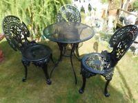metal black garden table and three metal black garden patio chairs