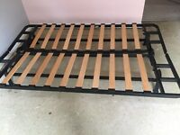 New Ikea sofa bed with black metal frame and wooden slats