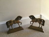 Brass horse door stops