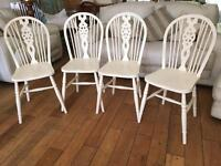 A LOVELY SET OF FOUR SHABBY CHIC CHAIRS WITH DESIGN TO THE CENTRE BACKS