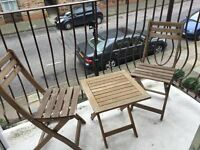 Outdoor wood chairs and table - great for city balcony