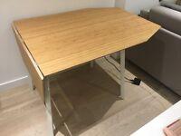 Drop-leaf IKEA dining table