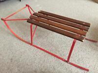 Vintage sleigh makes beautiful little table