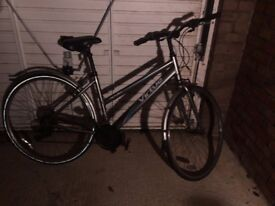 2 x Hybrid Bicycles - Mens Apollo Envoy and Ladies Apollo Virtue