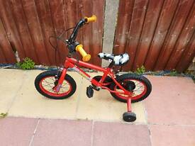 Small boys bike with stabilizers
