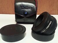 Shnaider componar-s2.8/50 lens with leather box and second lens also with box! very good condition!