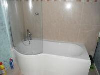 keyhole bath, screen, shower and handbasin