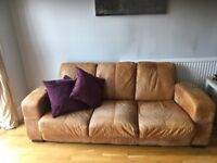 DFS Ranch colour leather sofa. 4 years old.