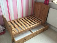 Pine nursery furniture set; cot bed, wardrobe, chest of drawers, shelves