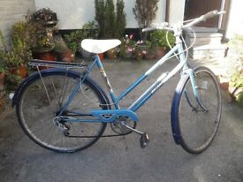 "Ladies Raleigh Estelle Bike. 5 Speed with 26"" wheels, stand and rack. Condition fair."