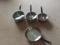 Set of 4 stainless steel pots and frying pan
