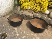 Pair of Vintage cast iron ovens.