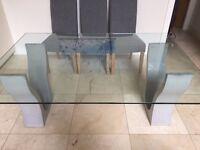 Bespoke glass dining table with designer concrete base