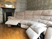 Beige swede reclining round corner used sofa.