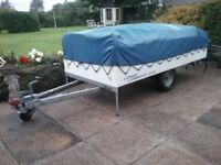 Trailer tent with awning. Includes camp kitchen with cooker/sink/storage. Can be pulled by small car