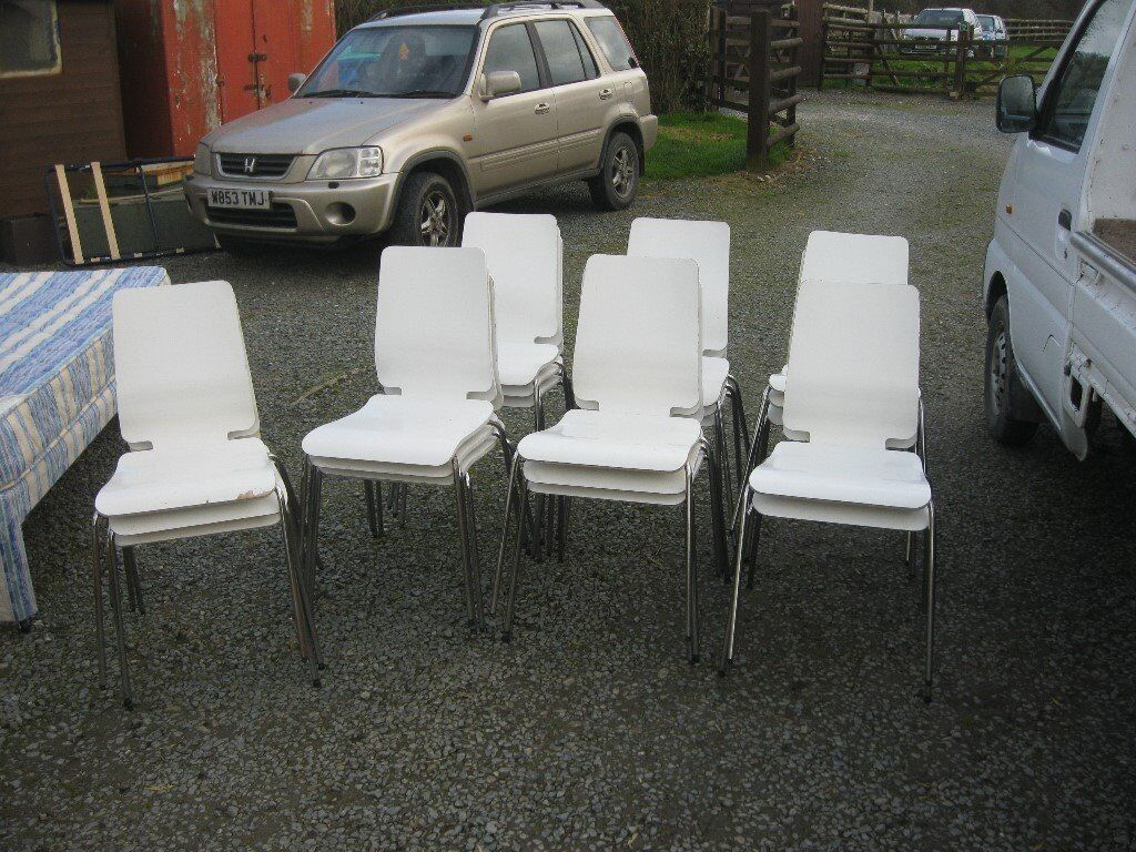 MODERN ORNATE WHITE IKEA 'GILBERT' STACKING CHAIRS. SOLD INDIVIDUALLY. (20 AVAILABLE IN TOTAL).
