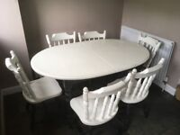 Oval dining/kitchen table, painted solid pine, with 6 chairs.