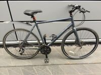 Expensive Ridgbak fluid disc brakes, 27 speed nice mudguard and lights included hybrid bike