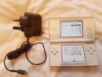 Nintendo DS Lite Console with Brain Training Cartridge and Charging Adapter