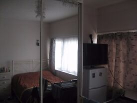 Spacious bedsit conveniently located next to tram stop.