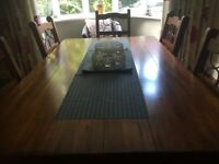 Dining table, chairs and sideboard.