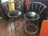 Two chrome stools