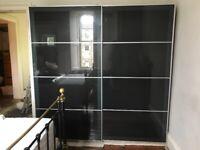 Large IKEA Pax wardrobe with Hokksund blue-black sliding doors