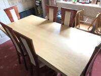 Marble dining table and six solid wood chairs.