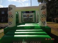 FOOTBALL CRAZY BOUNCY CASTLE 12ftx12ft GC (needs new cert) incs Fan/pegs - private or hire use